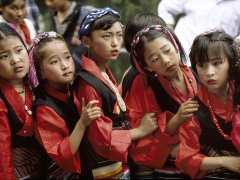 Girls in formal ceremonial dress
