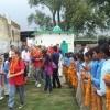 Students visiting village school